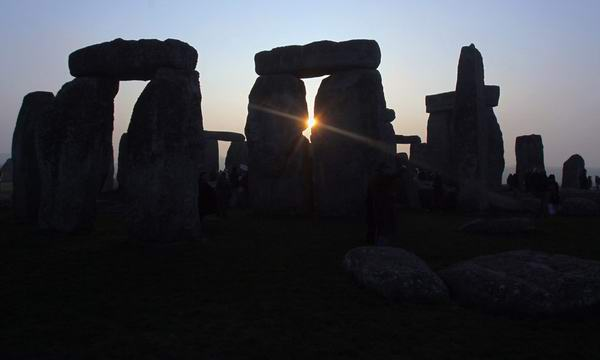 sun rises over Stonehenge